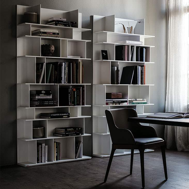 White Italian book case stocked with books