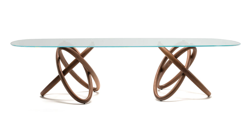 Italian dining table with a glass top and artistic wood base