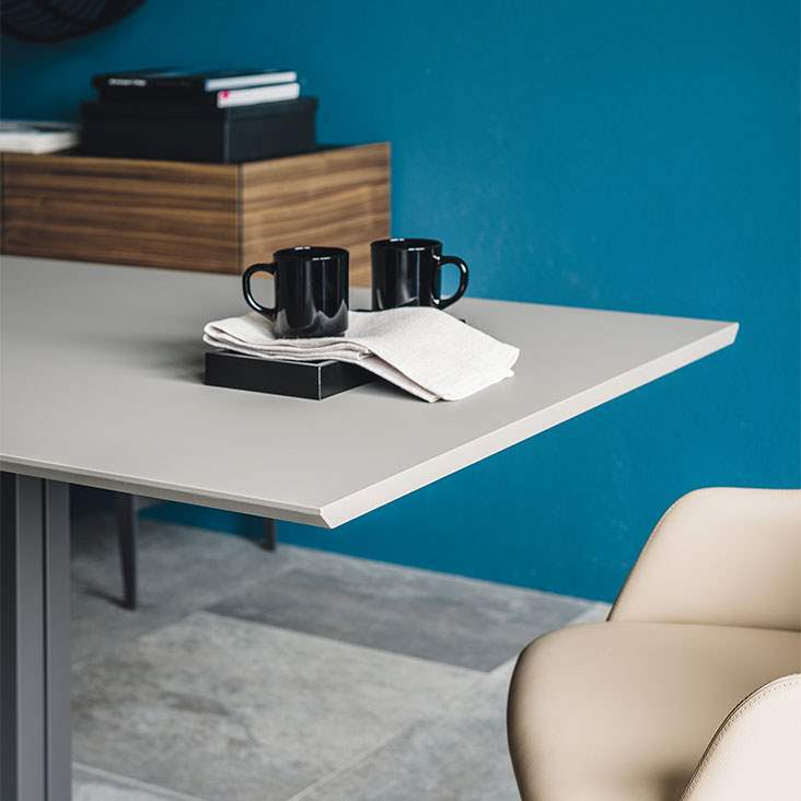 Italian dining table by Cattelan Italia in front of blue wall