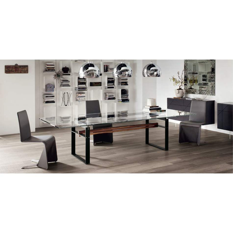 dining room full of Italian furniture and glass top table by Cattelan Italia