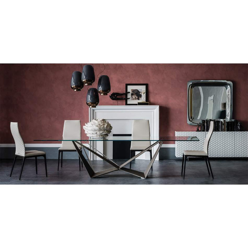 Dining table with glass top and metal base  by Cattelan Italia