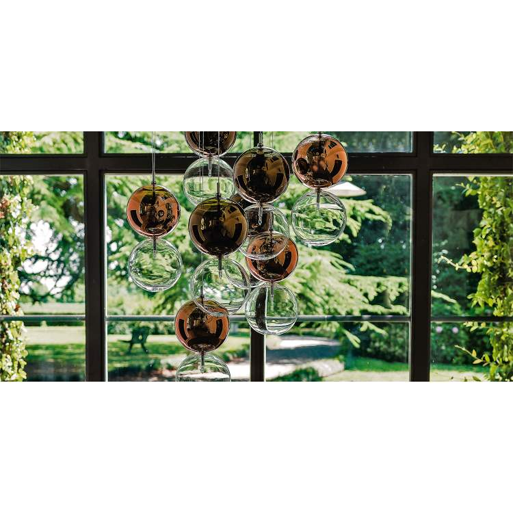 Chandelier with glass bulbs and scenic green background