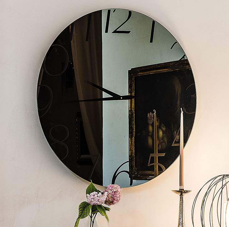 Glass clock with modern styling by Cattelan Italia