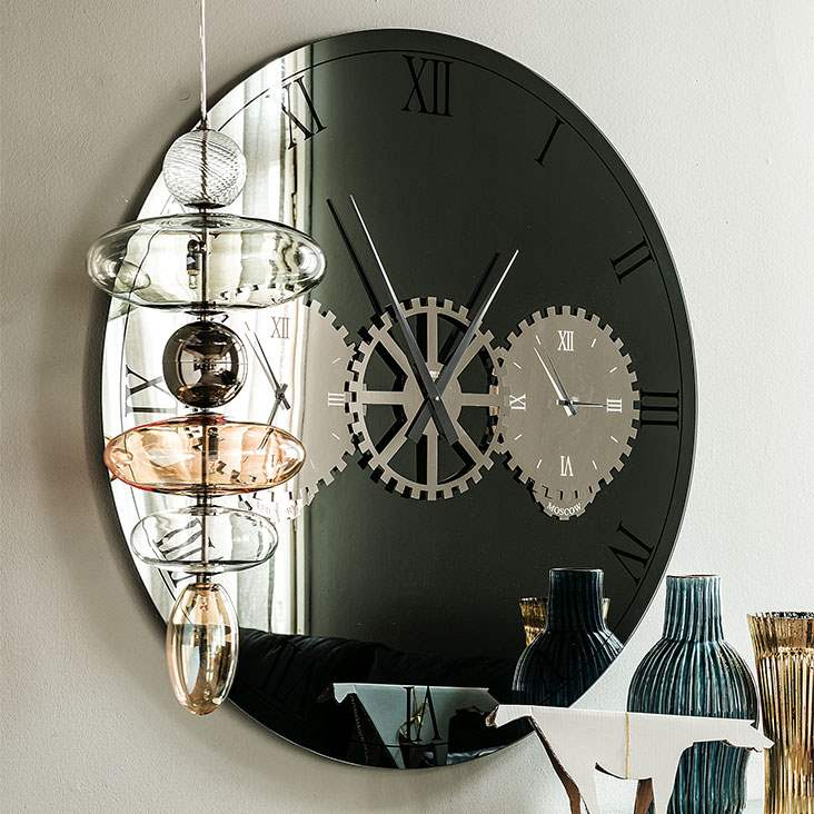 Modern mirror wall clock designed by Cattelan Italia