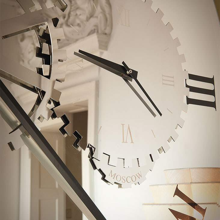 Up close view of the mirror on the Times mirror wall clock.