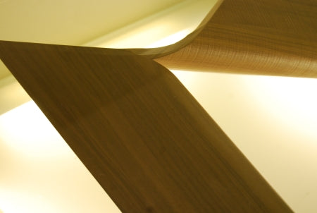 Close view of sculpted wooden base of Italian coffee table