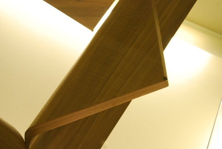Close view of wood sculpted base of Italian Coffee table