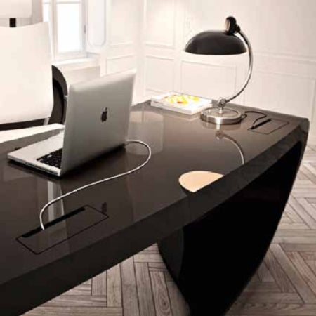 Italian desk with lamp and apple laptop on it