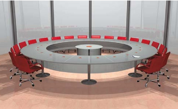 Large round luxury conference table surrounded by red chairs