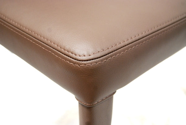 Up close view of leather on the Bella Side dining chair in leather by Frag