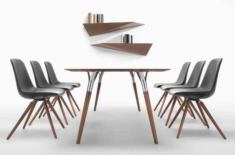 Dining table surrounded by chairs made in Italy by Tonon