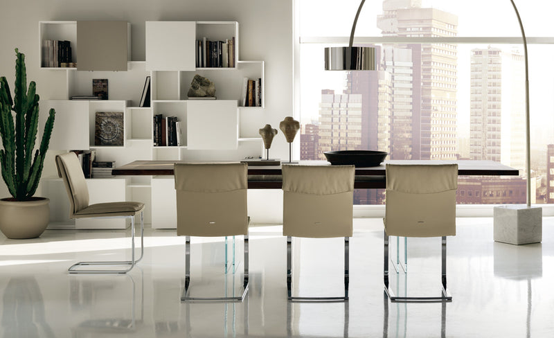 Ikon Drive Expandable Table side view with white chairs