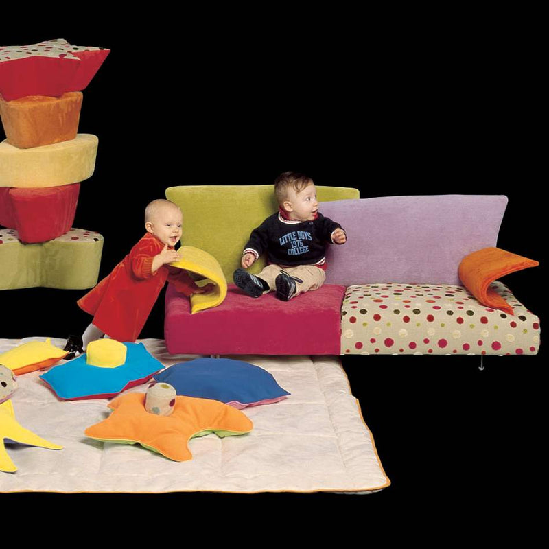 Italian children sitting on kid's couch