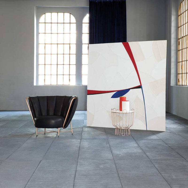 Room with designer luxury chair and modern art piece