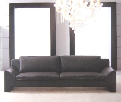 Modern black leather sofa with chandelier hanging over it