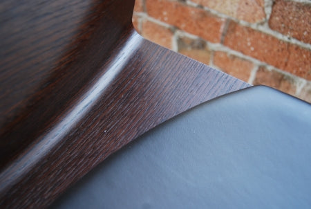 close view of bar stool leather and wood grain