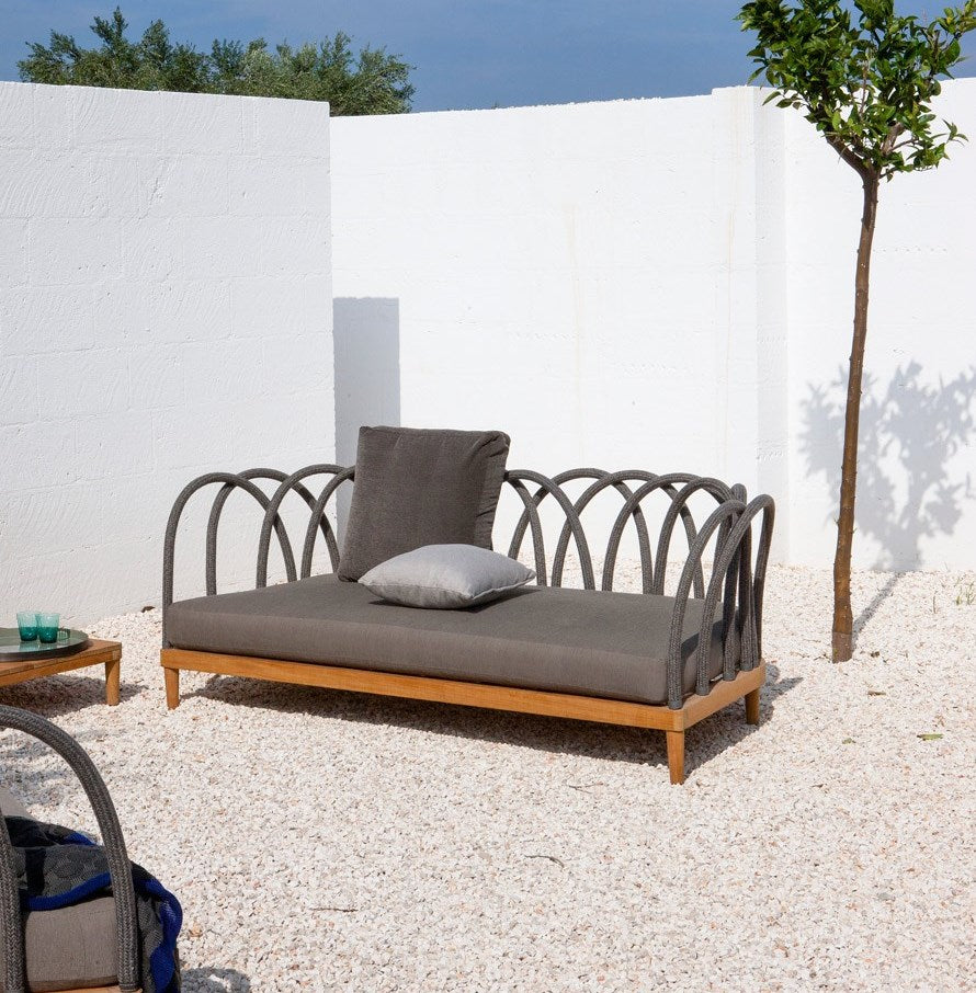 Italian courtyard with designer sofa by Unopiu