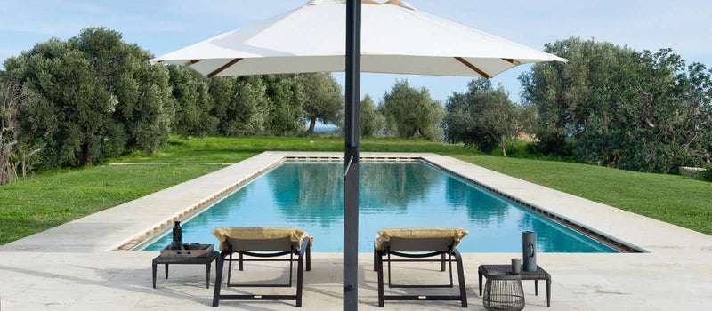 pool surrounded by outdoor Italian furniture