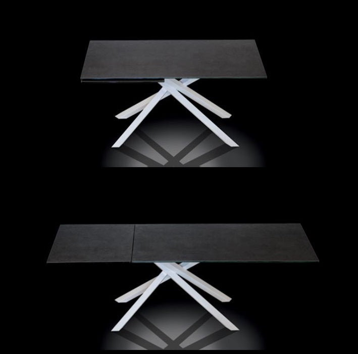 Boogie Expandable dining table by NAOS in small and expanded configurations