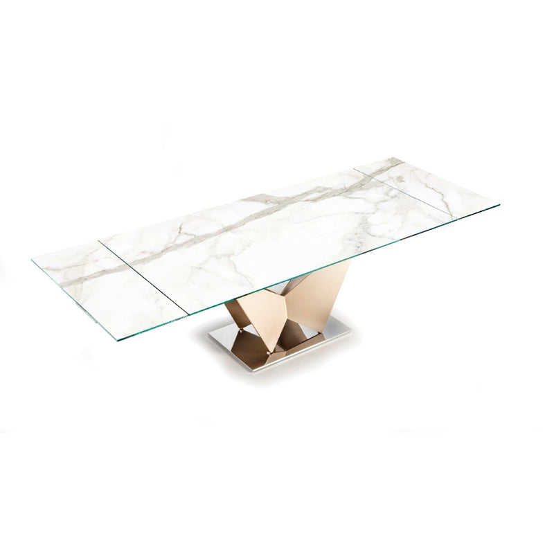 Expandable glass topped dining table in medium configuration