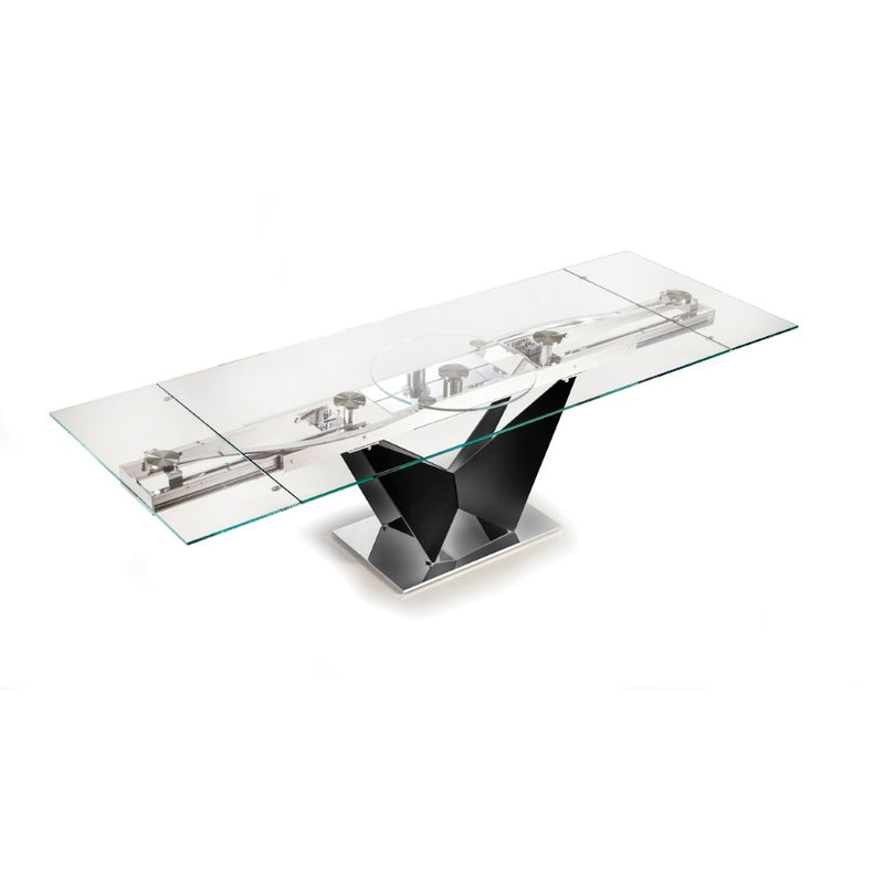 Expandable glass topped dining table in fully expanded configuration