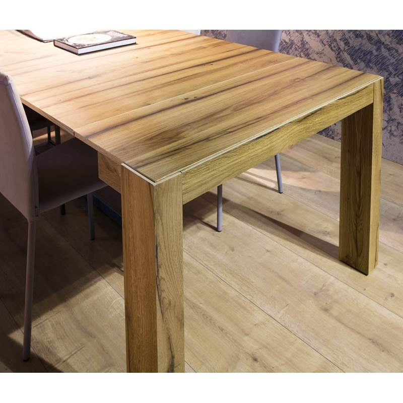 close view of the A 3 expandable tables wood grain