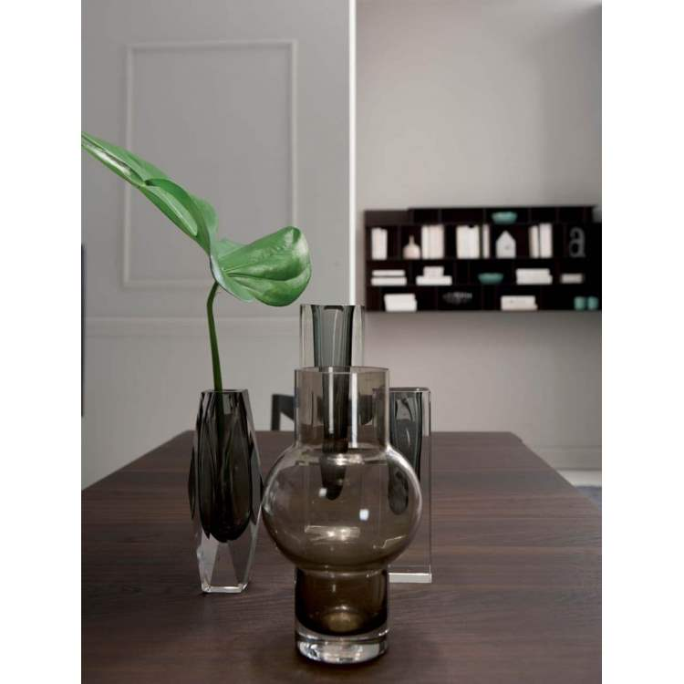 dining table with vase and plant on top