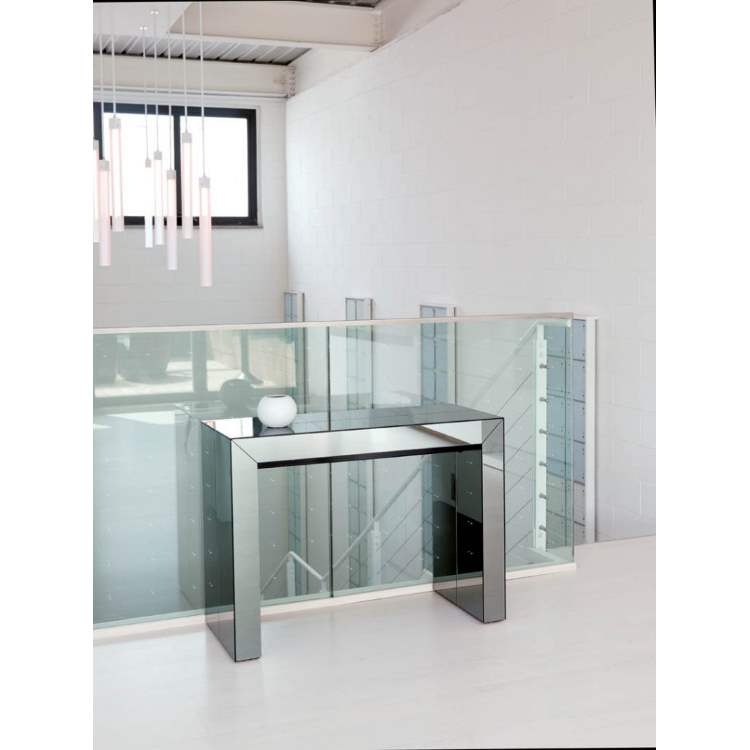 expandable dining table against glass wall