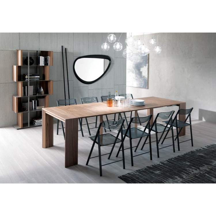 Italian dining table with chairs around it