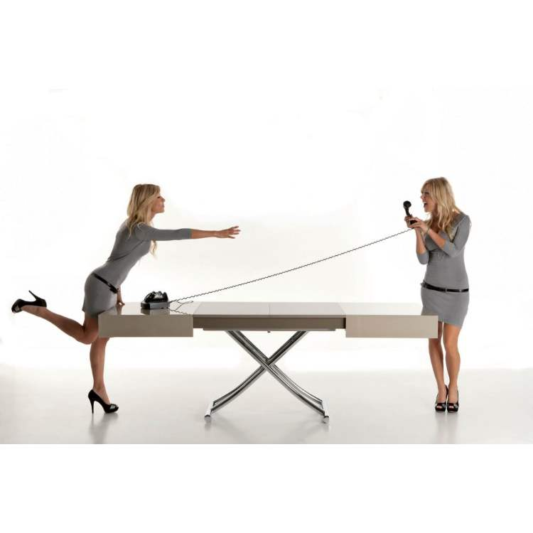 Two Italian women adjust the size of a coffee table