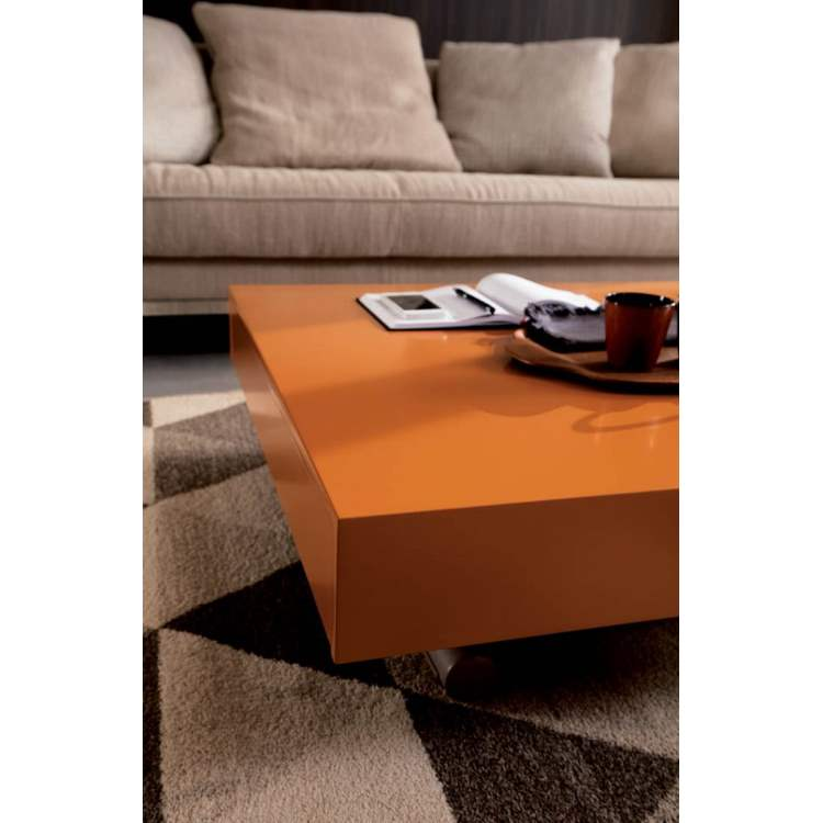 Expandable dining table configured as a coffee table