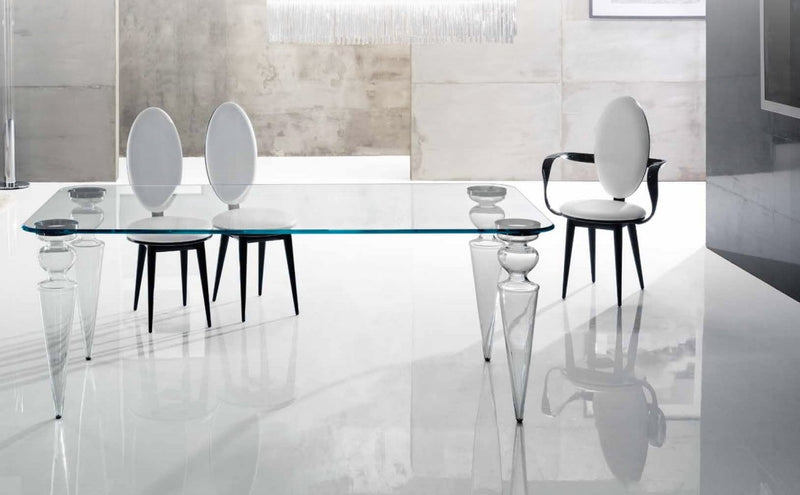 dining table with designer dining chairs surrounding it