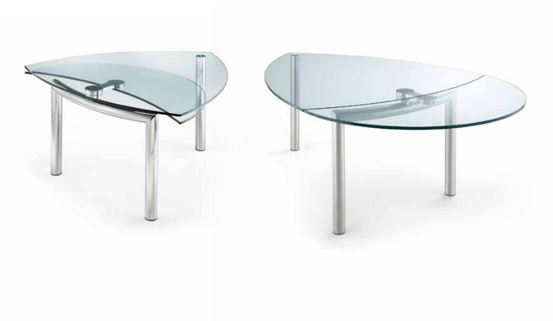 Two Policleto Goccia dining tables in expanded and un-expanded configurations