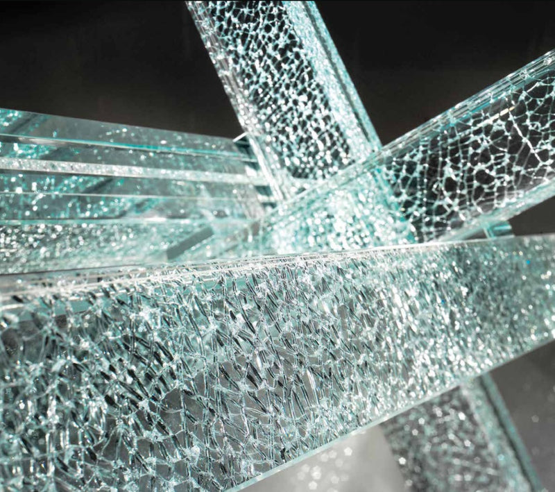 Close view of glass star base of Italian Transeo 72 Craquele Table
