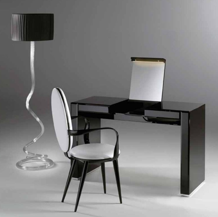 Desk with designer Italian lamp next to it