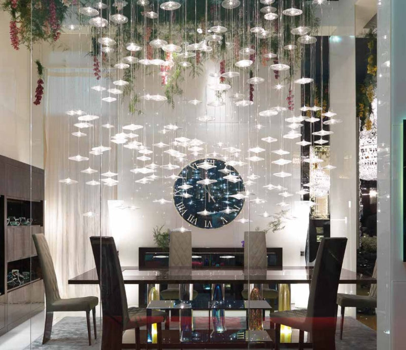 Dining room full of luxury furniture and dazzling glass chandelier