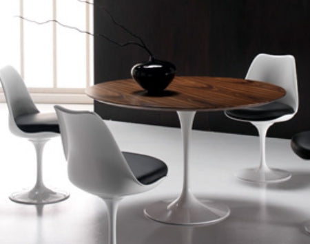 Eero Saarinen Dining Table surrounded by chairs
