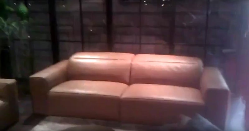 two seat tan leather sofa made in Italy by Ego Italiano