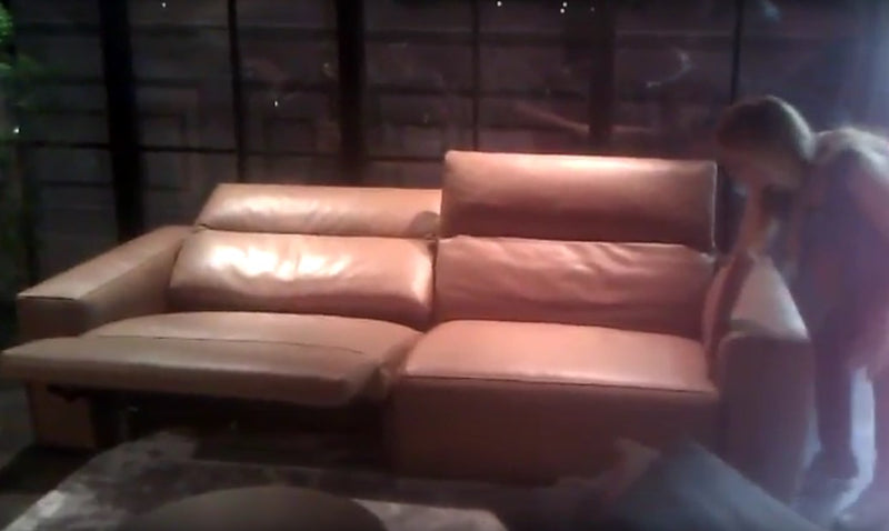 Leather sofa with one section in reclined position