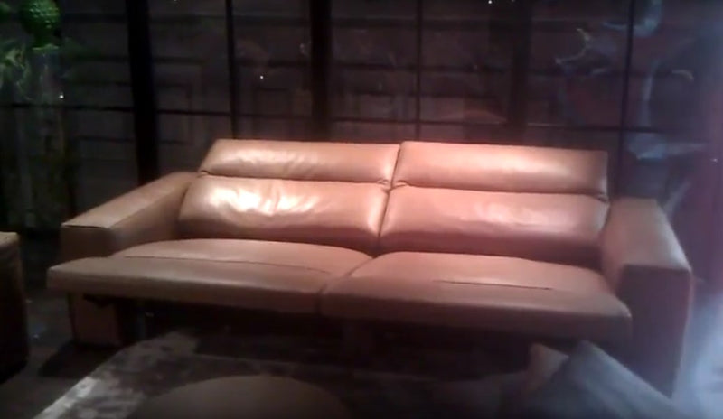 Italian sofa with both sections in reclined position