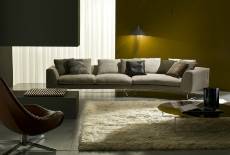 White leather sofa made in Italy displayed in a modern luxury living room
