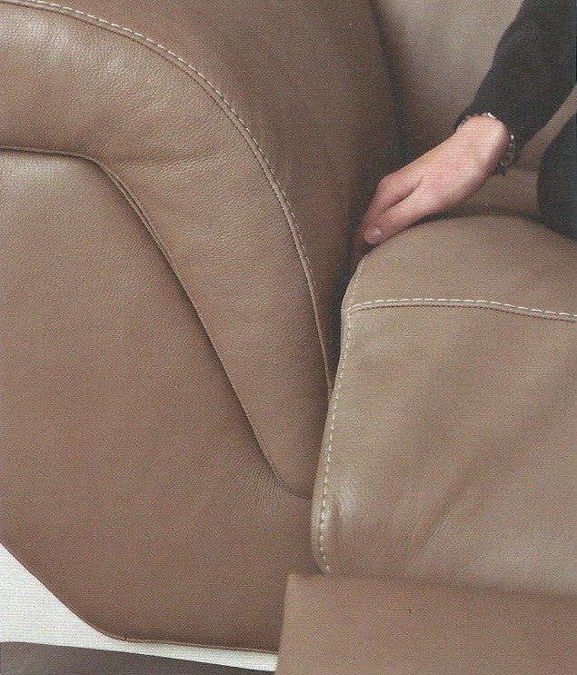 close up image of Italian brown leather sofa