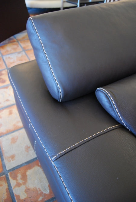 Close view of black leather on Italian couch