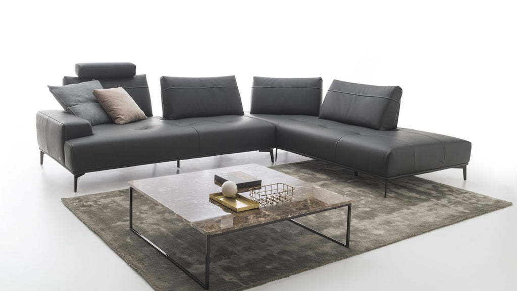 Room with black Italian sofa and coffee table