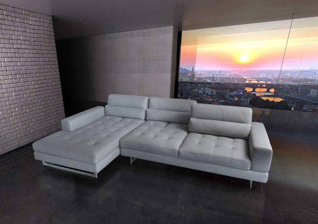 White leather Italian sofa with sunset in background