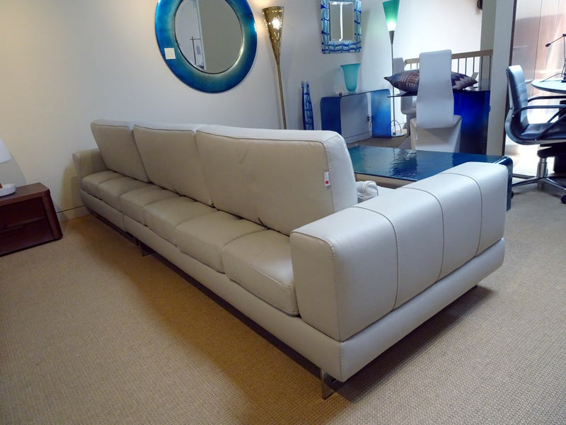 rear view of sectional white leather sofa made in Italy