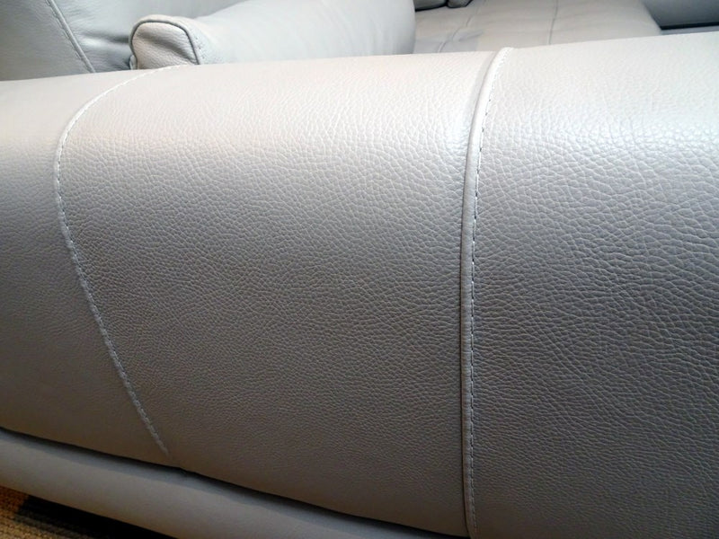 Close view of sofa's white leather
