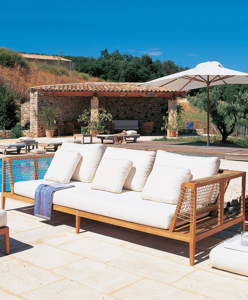 Outdoor sofa with wooden frame and white cushions