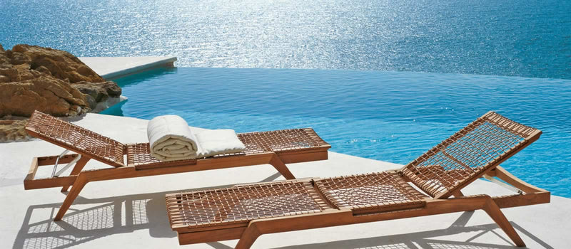 View of Synthesis Sun Lounger designed by Unopiú by the pool