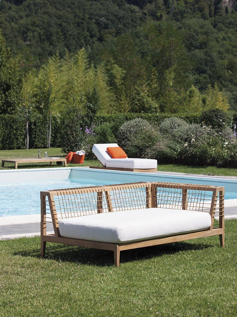 Synthesis Sofa on grass next to pool